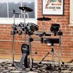Alesis Surge Mesh Kit + Strike Amp 12 | 8-Piece All-Mesh Electronic Drum Kit with Mesh Heads Bundled with 2000-Watt Ultra-Portable Powered Drum Speaker/Amplifier 1